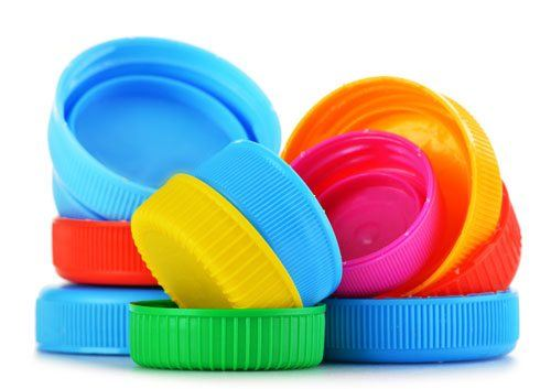 Stellar Manufacturing Polymer Industry Expertise - Image of colorful plastic caps