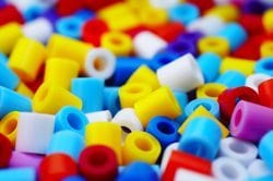 Compaction Granulation and Polymer Products - Image of multi-colored plastic components